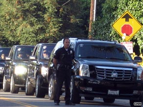 A motorcade leaves the Jackson family home in Encino, California, early Tuesday.