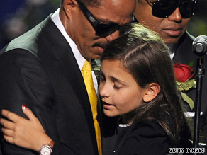 Paris Jackson, 11, is consoled by her uncle after delivering a tearful tribute to her father, Michael Jackson.
