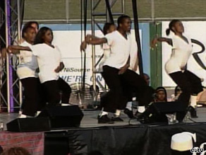 A group pays tribute to Michael Jackson by performing some of his signature moves.