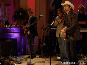 Country music star Brad Paisley performs at the White House in front of the president and members of Congress.