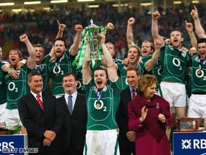O'Driscoll lifts the Six Nations trophy after their grand slam triumph in Cardiff.