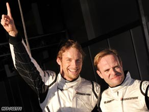 Button (left) and Barrichello celebrate their qualifying success at Albert Park.