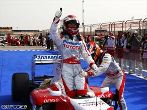 Trulli gives a thumbs up after claiming pole for Toyota in Bahrain.
