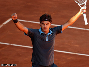 Roger Federer celebrates after beating Rafael Nadal in the Madrid Open final