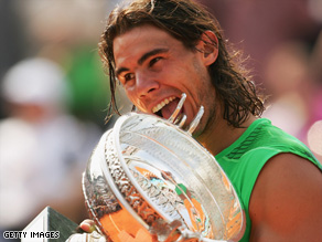 Rafael Nadal bites into the French Open trophy after winning the tournament last year, his fourth in a row.