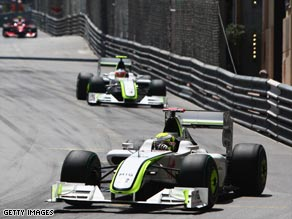 Button leads home Brawn team-mate Rubens Barichello as he claims his fifth Formula One victory of the season.