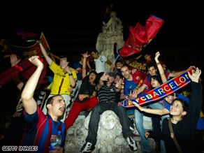 Barcelona fans celebrate in the city's Las Ramblas thoroughfare early Thursday morning.