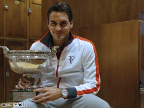 Roger Federer finally gets his hands on the French Open title after beating Robin Soderling.