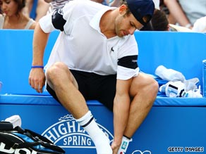 Andy Roddick feels his ankle injury before retiring from his semifinal against fellow-American James Blake.