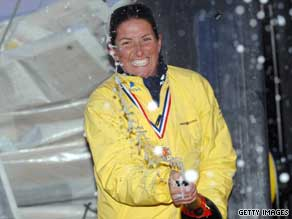 Dee Caffari celebrates completing the solo Vendee Globe race earlier this year.