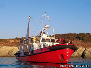 The old tug-boat, Le Mangier, has been converted into a eco-friendly vessel with three sails and solar panels.