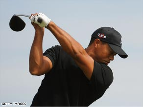 Woods hones his game ahead of the third major of the season at Turnberry.