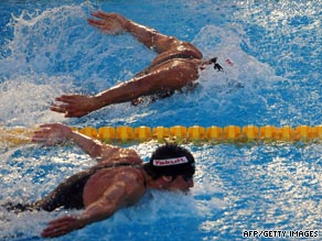 Michael Phelps, below, was neck and neck with Serbian rival Milorad Cavic in the closing stages of the race.