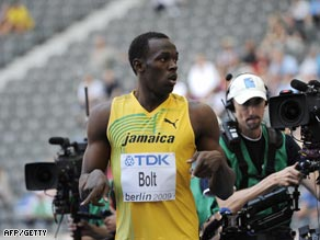 Bolt reacts after coasting to victory in his 100m heat in Berlin Saturday.