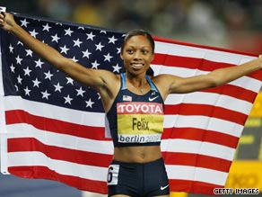 Felix celebrates winning her third successive world 200m title in Berlin on Friday.