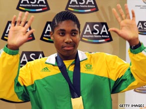 Semenya shows off her gold medal after returning to South Africa as the world 800m champion.
