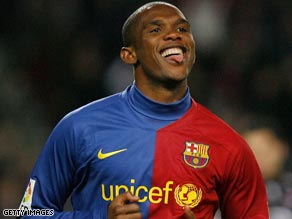 Samuel Eto'o scored his 20th and 21st goals of the season as Barcelona defeated Sporting Gijon 3-1.