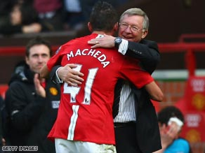 Macheda receives a hug from manager Sir Alex Ferguson after scoring Manchester United's last-gasp winner.