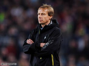 A dejected Klinsmann watches on as his side slip to defeat in the Nou Camp.