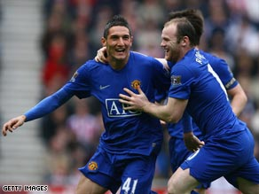 Macheda (left) is congratulated by Rooney after getting the decisive touch at Sunderland.