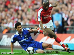 Michael Ballack leaves his mark on Wembley's 'spongey' pitch during the semifinal win against Arsenal.