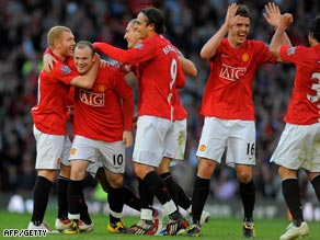 United's players celebrate a Rooney goal during the second half revival at Old Trafford.