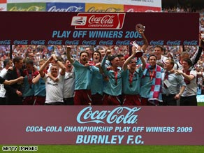 Burnely players celebrate returning to the top flight of English football for the first time in 33 years.
