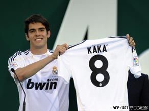 Kaka parades his new Real Madrid jersey after completing his $56 million euros transfer to the Spanish giants.