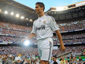 Cristiano Ronaldo is paraded in front of 70,000 pasionate supporters at a packed Bernabeu stadium.