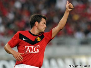 Michael Owen celebrates his winning goal on debut for Manchester United against a Malaysia XI.