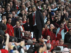 Arsene Wenger has to stand with Manchester United fans after being sent off at Old Trafford.