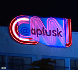 A banner with Ashton Kutcher's Twitter name, aplusk, was unfurled Wednesday over the CNN logo at CNN Center.