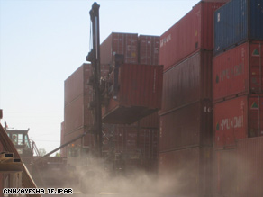 Steel shipping containers, like these at a depot, can be turned into homes.