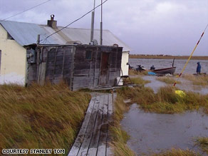Floodwaters rip through the village of Newtok, Alaska, destroying its infrastructure.