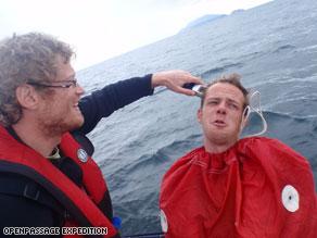 High seas high jinx: Tobias gives his shipmate Hanns a haircut at sea using a sail bag as a barber cape.