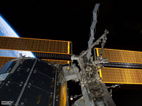 The solar panels installed to the space station are seen Thursday with Earth in the backdrop.