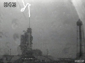 Image from NASA TV shows a lightning strike Friday night near the shuttle launch pad.