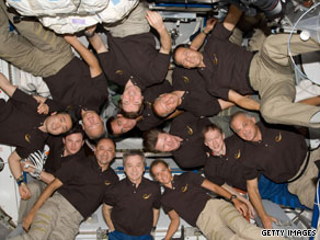A record 13 astronauts were assembled in space when the Endeavour crew met with space station inhabitants.
