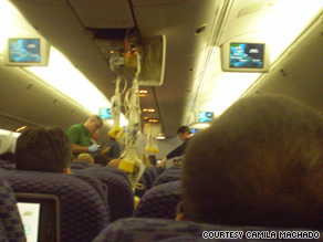A passenger's photo shows oxygen masks hanging from the ceiling on Monday's Continental Flight 128.