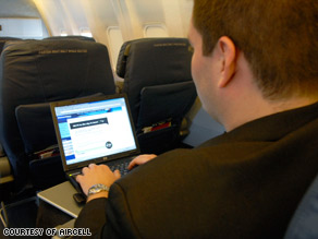 An American Airlines passenger uses Wi-Fi to access the Internet during a flight.