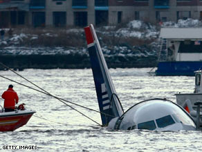 Crews prepare to tow the US Airlines Airbus A320 that crash-landed in the Hudson River on Thursday.