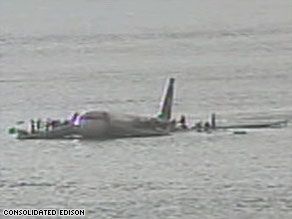 Surveillance video shows passengers of US Airways Flight 1549 hurrying onto the plane's wings on January 15.