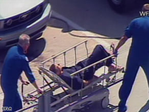 Boater Nick Schuyler, identified by WFLA, is seen here on a stretcher Monday after his rescue.