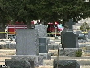 The plane crashed Sunday near a cemetery about 500 feet from an airport runway, officials said.