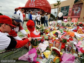 Fans gather around a memorial for Los Angeles Angels pitcher Nick Adenhart on Friday.