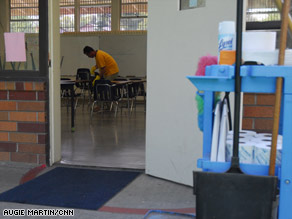 John Garcia disinfects a classroom at St. Mel Catholic School in Fair Oaks, California.