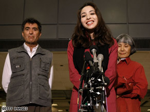 Roxana Saberi and her parents give a news conference at Dulles International Airport on Friday.