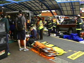 Medical personnel treat the injured Saturday at West Portal Station, where a light rail car hit another.