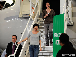 Freed journalist Euna Lee is followed by Laura Ling as they step off their plane Wednesday in California.