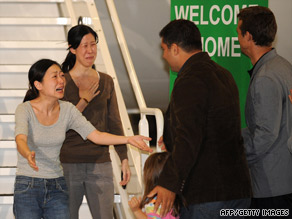 The families of Euna Lee, left, and Laura Ling greet them Wednesday in California.